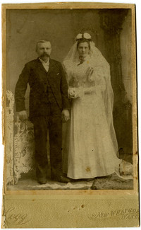 Mr. Jorgan Anderson and Mrs. Hilda (Lind) Anderson stand in studio wedding portrait