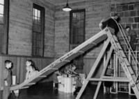 1943 Sliding In The Primary Grades Play Room