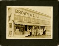 Several clerks stand in doorway of Brown & Cole Meats & Groceries, Bellingham, Washington