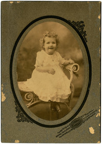 Studio portrait of seated young girl
