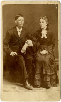 John Leonard Snyder and Olive Axtell Snyder pose in seated studio portrait