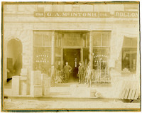 Chip Groom, G.A. McIntosh, Frazer Jenkins and unidentified man in from of G.A. McIntosh general store