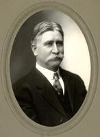 Studio portrait of Ed Cowgill