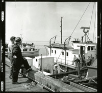 Two men standing on a pier