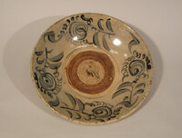 Plate decorated with blue design of four floral sprays