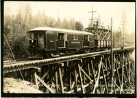 Trellised railway bridge with two rail cars