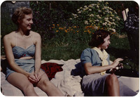 Two women sunbathing on blanket