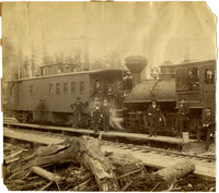 Several men stand before engine and caboose of BB&BCRR, the Bellingham Bay and British Columbia Railroad