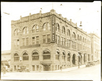 Exterior of the L.D. Pike building at northeast corner of Holly and State Streets with electric trolly wires strung over streets