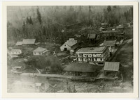Aerial view of early Glacier, WA, with BB&BC railroad, train depot, houses, community hall, Glacier Hotel