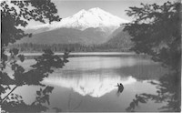 Unidentified lake (possibly Baker Lake) with snow-covered Mount Baker in the background