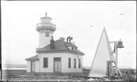 Close-up of New Ediz Hook Light Station with old bell fog signal.