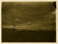 View over rooftops of Bellingham Bay and cloudy day looking towards Lummi Island