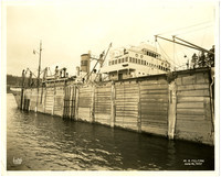 View of ship in drydock from exterior of dock