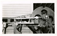 Close-up of an unidentified,metal, motorized cannery machine