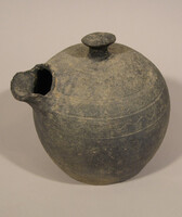 Globular pouring vessel with knob on top, short spout with incsed meander bands