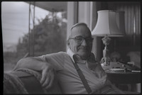 Unidentified man, likely Galen Biery, seated on a sofa