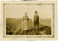 Unidentified man and woman in tilled field