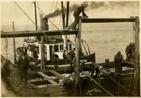"Fishtrap tender ""Sachem"" and crew pull alongside fishing barge"