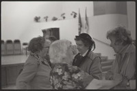 Four unidentified women standing in a group