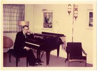 Man (likely Gunnar Anderson) seated at a piano
