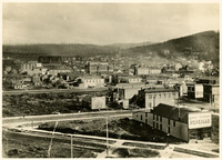 """View of early downtown Bellingham, Washington, with the """"Reveille"""" newspaper offices in foreground"""