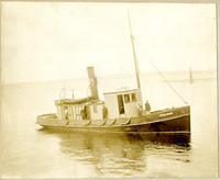 "Fishtrap tender ""Steelhead"" with several men on deck"