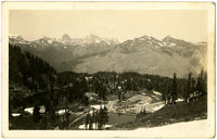 Postcard of Artist Point in Mt. Baker National Park, with two alpine lakes and cars in nearby parking lot