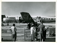 A Pan American World Airwys plane loading at the gate at an unidentified airport.