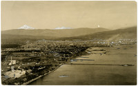 Aerial view of Bellingham and Bellingham Bay looking towards Mt. Baker on horizon