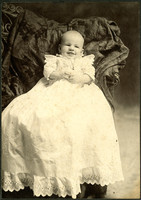 Baby in christening gown