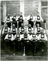Fifteen uniformed members of Fairhaven Fire Department pose on steps