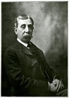 Studio portrait of seated Jim Wardner