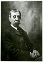 Studio portrait of seated Jim Wardner