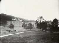 1908 Main Building: Front Facade with Horses