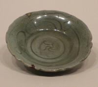 Plate with barbed rim and incised swirls under celadon glaze