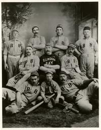 Formal studio portrait of nine players of the Bellingham Bays baseball team, and a bat boy, all in uniform