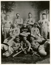 Formal studio portrait of nine players of the Bellingham Bays baseball team, and a bat boy, all in uniform
