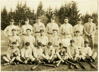 Fairhaven high school baseball team poses in tree rows with coach on athletic field, Bellingham, WA