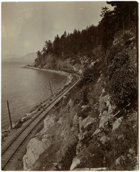 Great Northern steam train travels south along Chuckanut Mountain