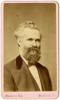 Formal studio portrait of older man with beard