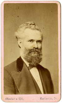 Formal studio portrait of older man with beard
