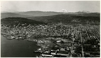 Aerial view of south Bellingham with foothills beyond, and Mount Baker in distance