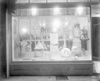 "Front display window of ""Brisbin's Millinery"""