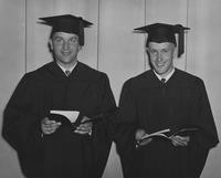 1949 Two Men Looking at their Degrees