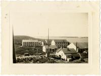 View of multiple buildings of Pacific American Fisheries facilities at Naknek Cannery, Alaska