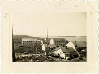 View of multiple buildings of Pacific American Fisheries facilities at Naknek Cannery, Alaska