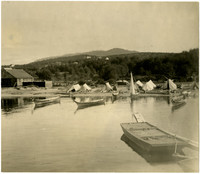 Native American beach encampment and canoes with Pacific American Fisheries cannery to left