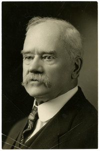 Studio portrait of A.F. Mills