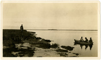 Three men in rowboat on Nelson River, Alaska, one man standing on marshy shore